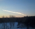 Парчета от астероида, който ще прелети довечера край Земята, паникьосаха руския град Челябинск. Въздушният взрив потроши витрини, стотици са ранени - видео
